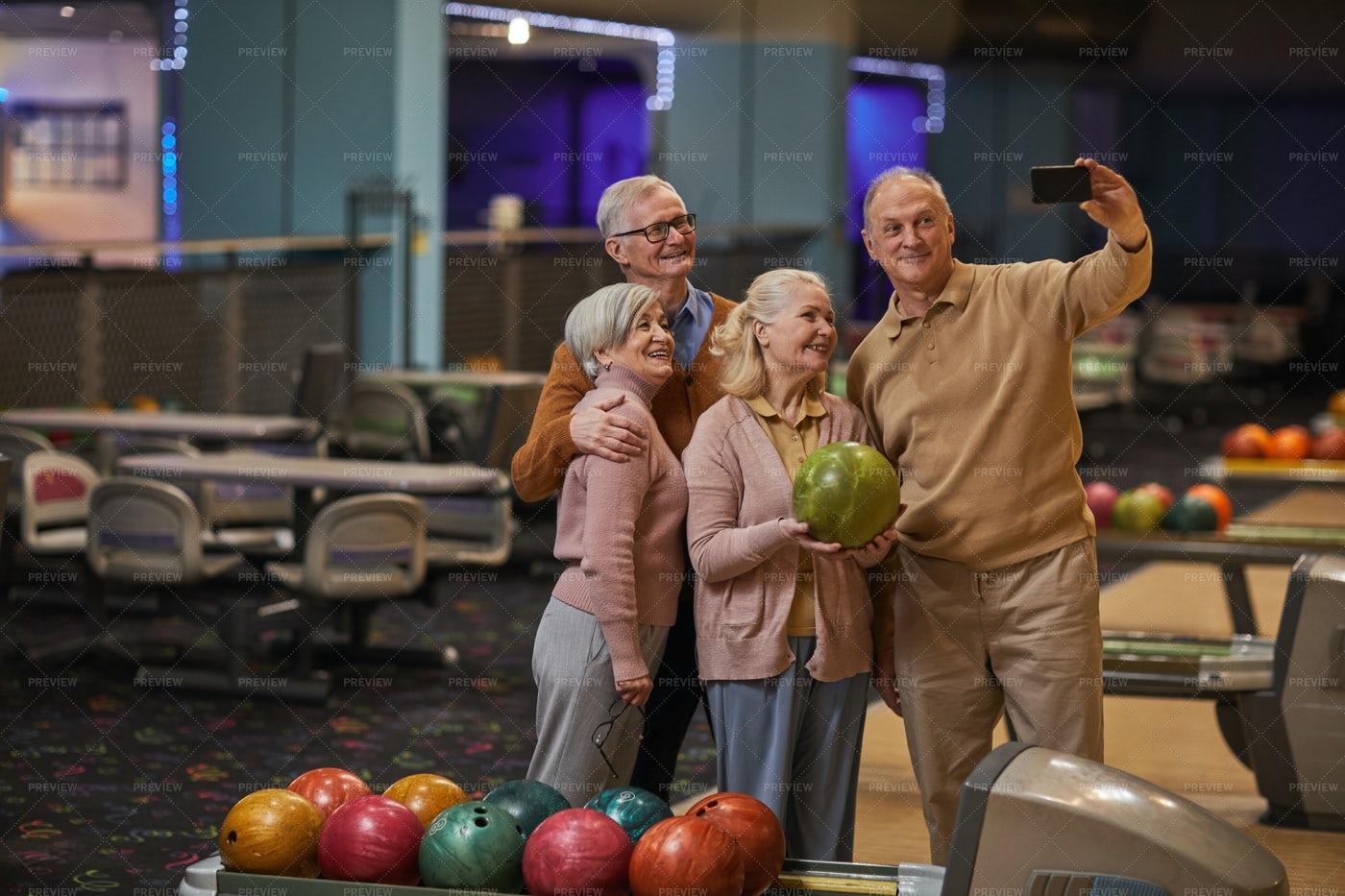 Senior People Taking Selfie At Bowling: Stock Photos