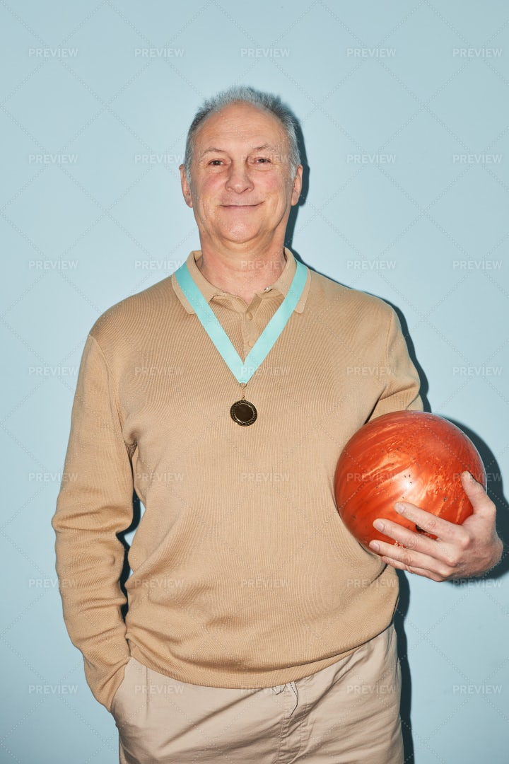 Older Bowling Player With Medal: Stock Photos