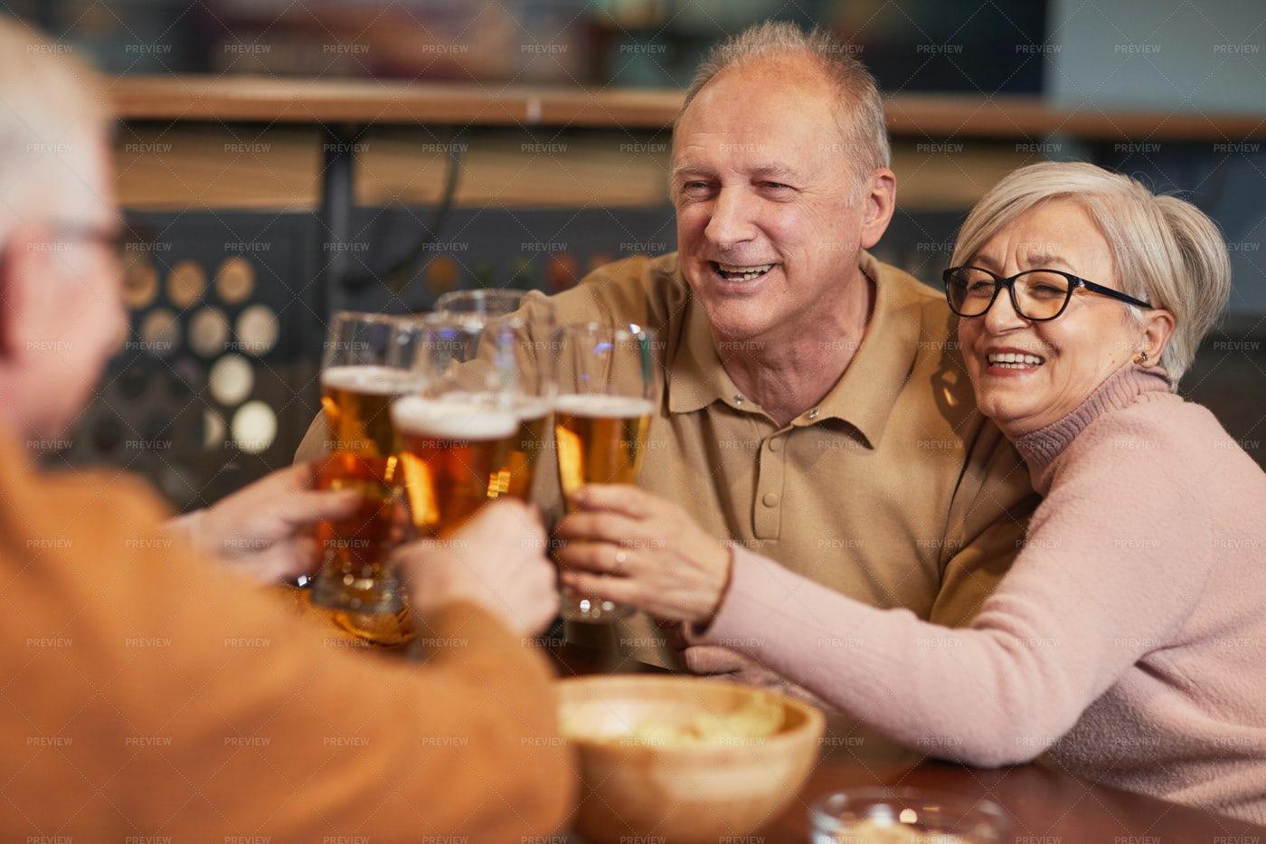 Senior People Enjoying Beer: Stock Photos