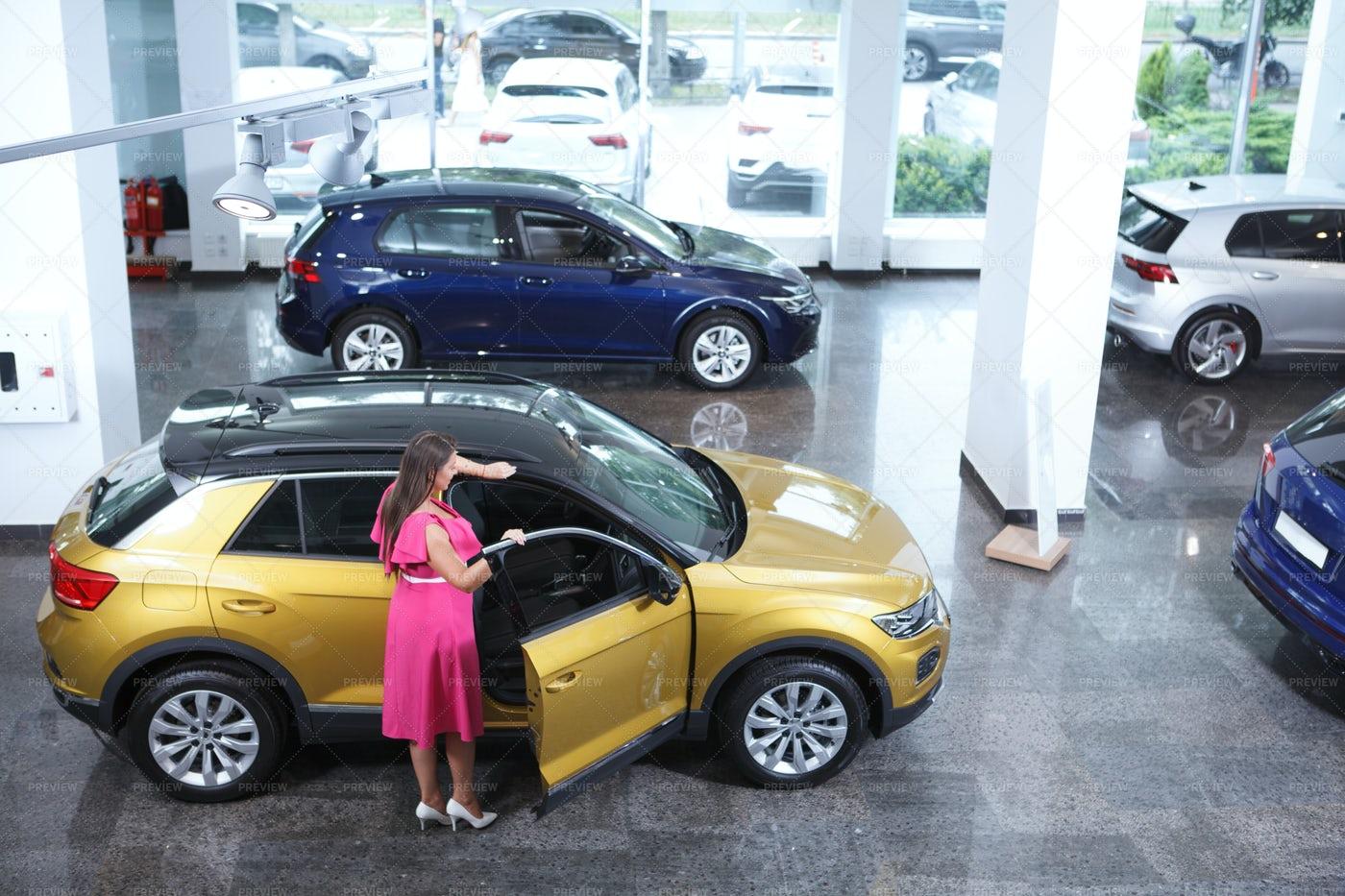 Woman Choosing New Auto: Stock Photos