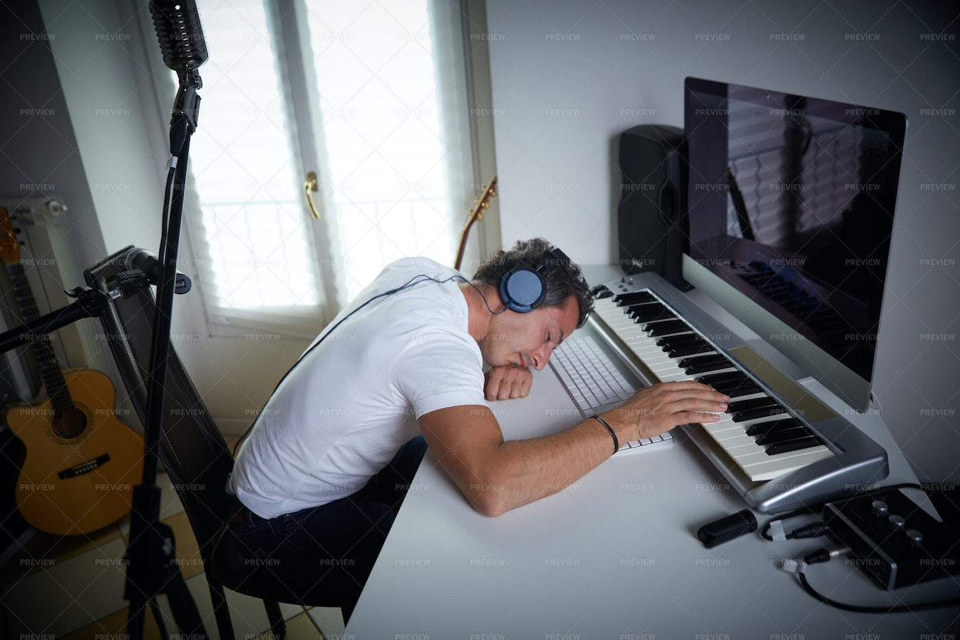 Exhausted Sound Producer: Stock Photos