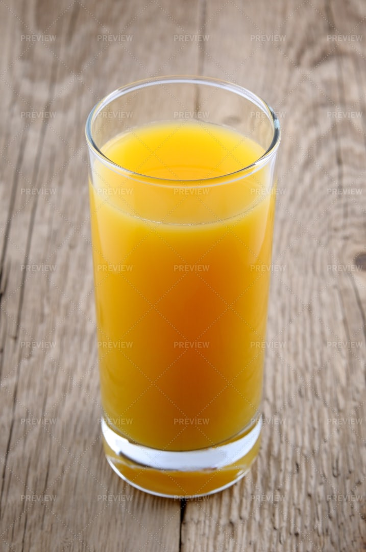 Glass Of Orange Juice On Wooden Table: Stock Photos
