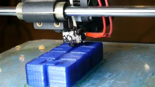 3D Printer Prints Blue Cubes : Stock Video