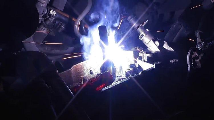 Welding In An Engine Block: Stock Video