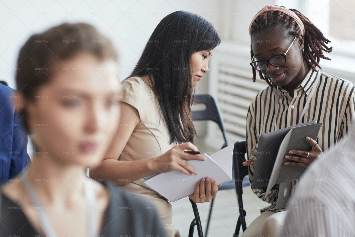 Two Businesswomen At Conference: Stock Photos