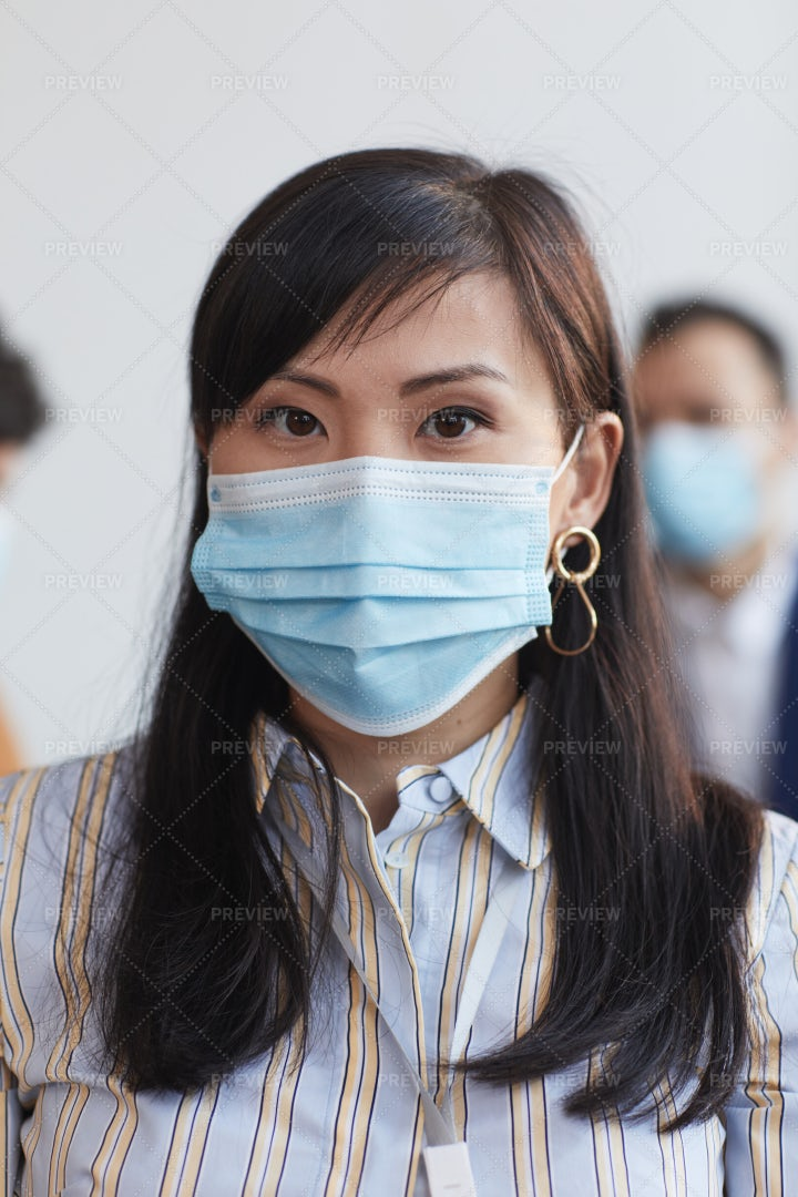 Portrait Of A Woman Wearing Mask: Stock Photos