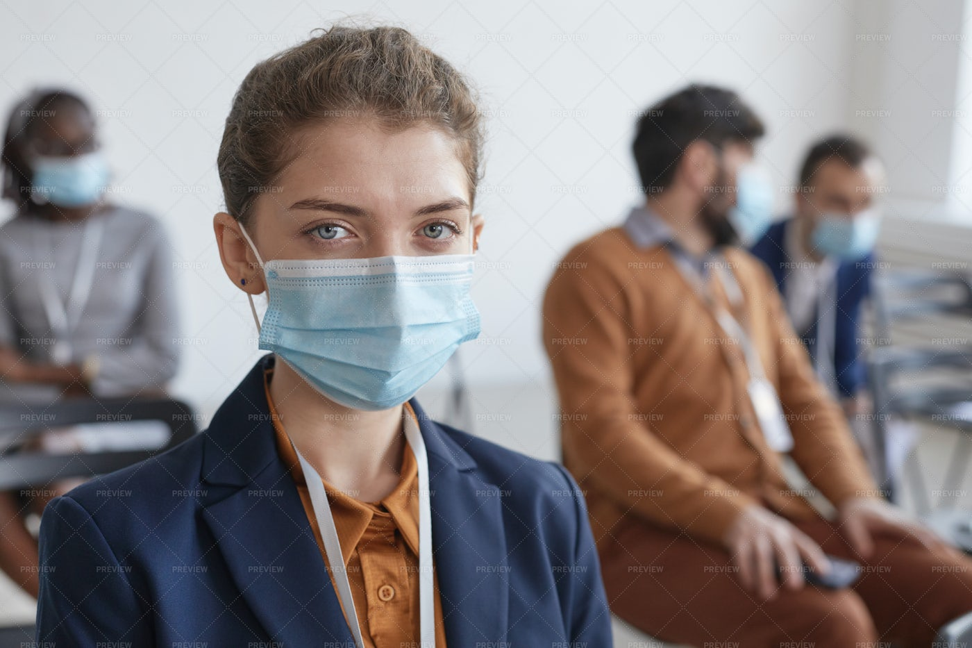 Woman Wearing Mask In Audience: Stock Photos
