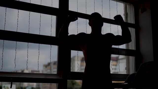 Man Flexing Muscles : Stock Video