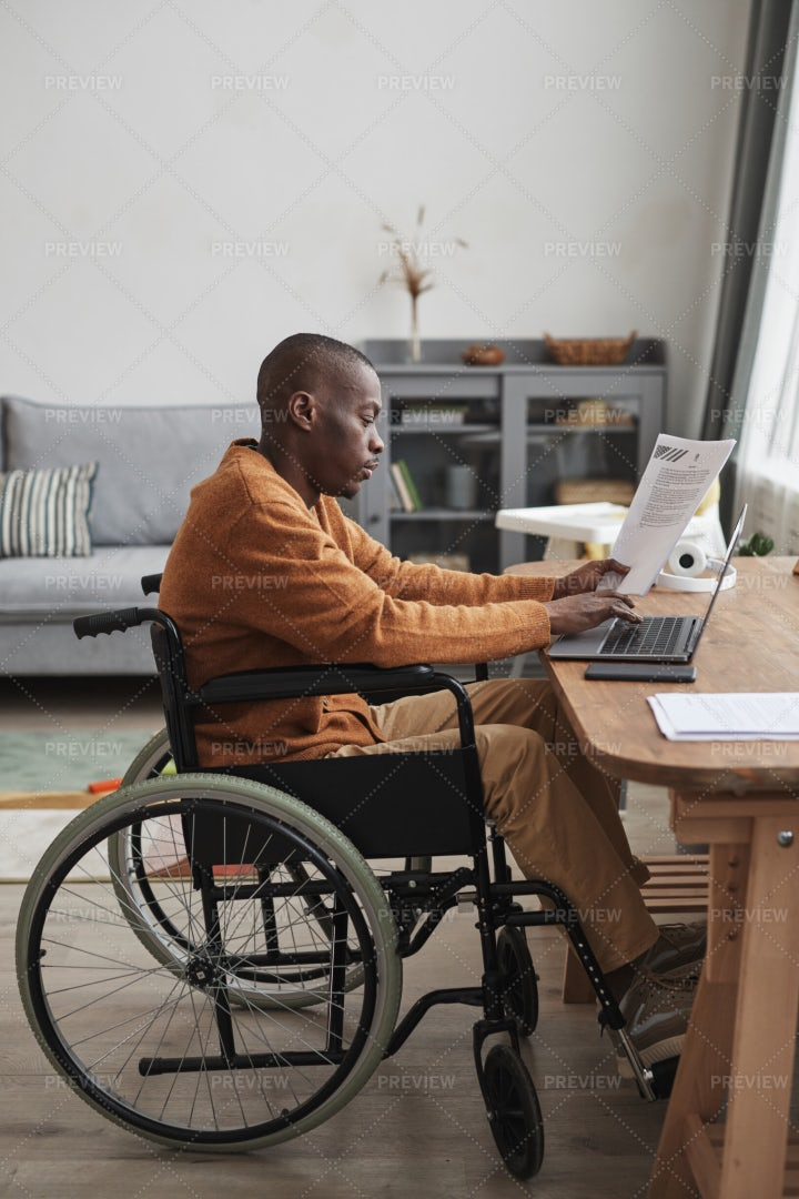 Handicapped Man Working From Home: Stock Photos