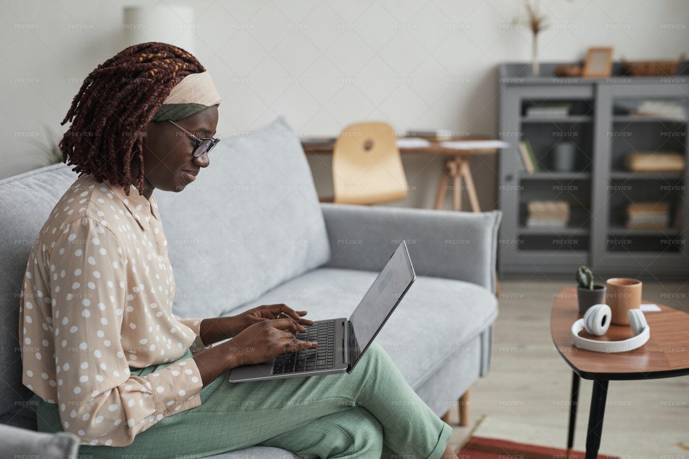 Woman Using Laptop At Home: Stock Photos