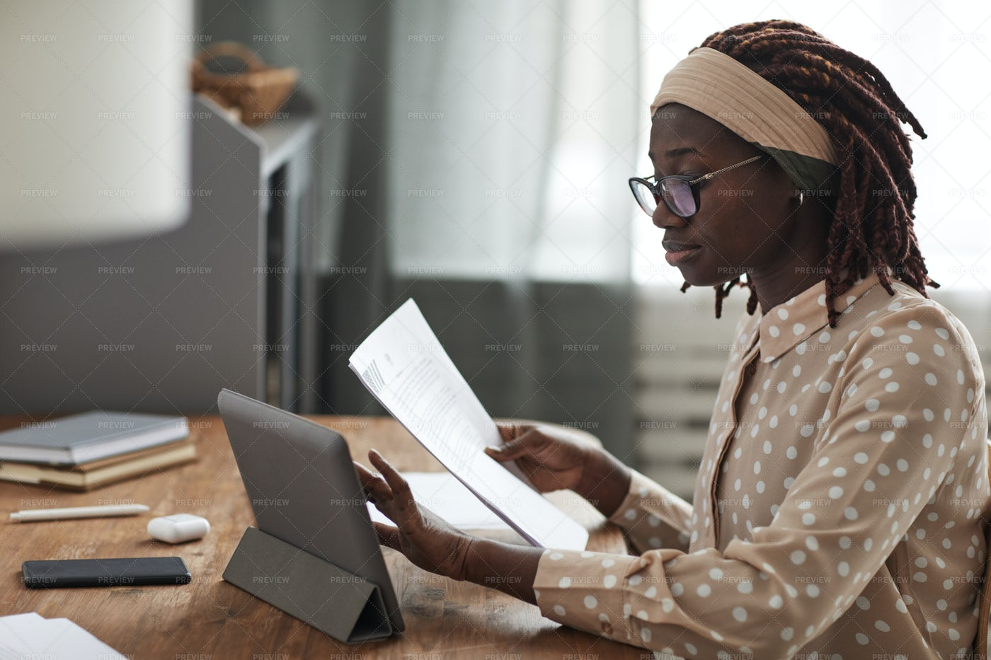Woman Studying Online Using A Tablet: Stock Photos