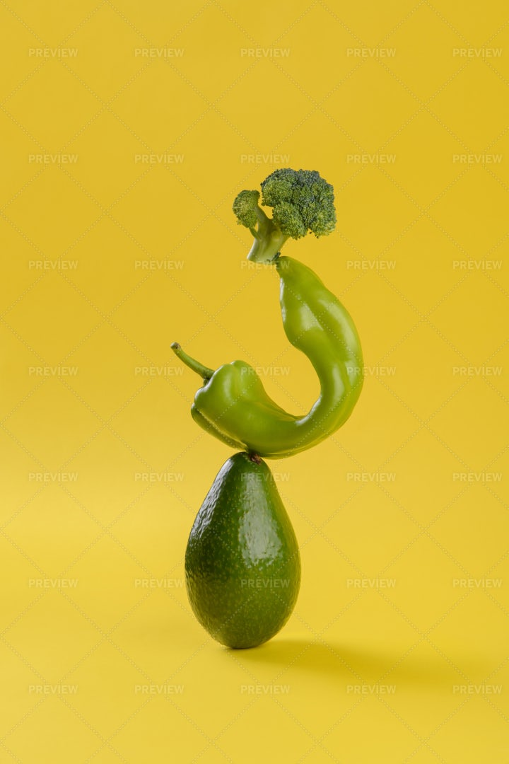 Green Vegetables On Yellow Background: Stock Photos