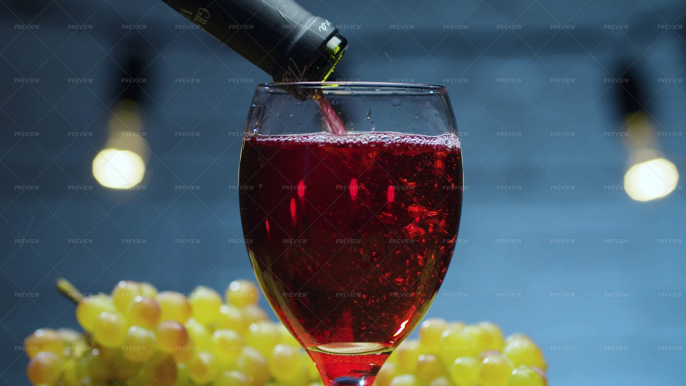 Red Wine Pouring Into A Glass: Stock Photos