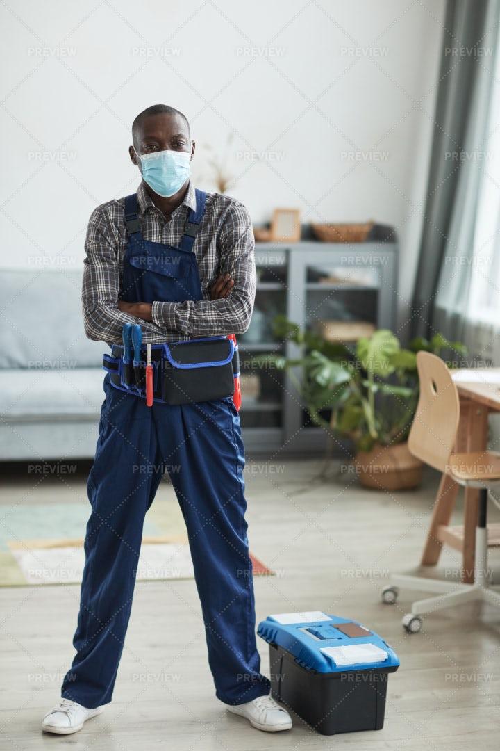 Handyman In A Protective Medical Mask: Stock Photos
