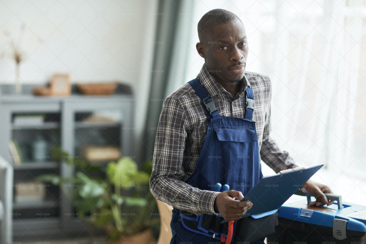 Portrait Of Handyman In A Client's Home: Stock Photos