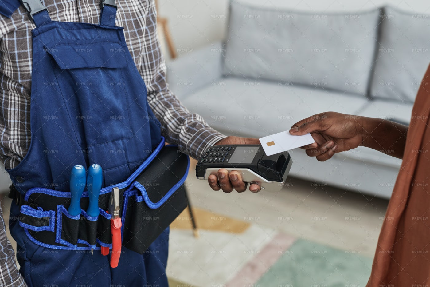 Woman Paying For Handyman Services: Stock Photos