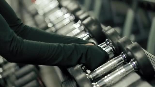 Female Athlete Picking Heavy Dumbbells: Stock Video