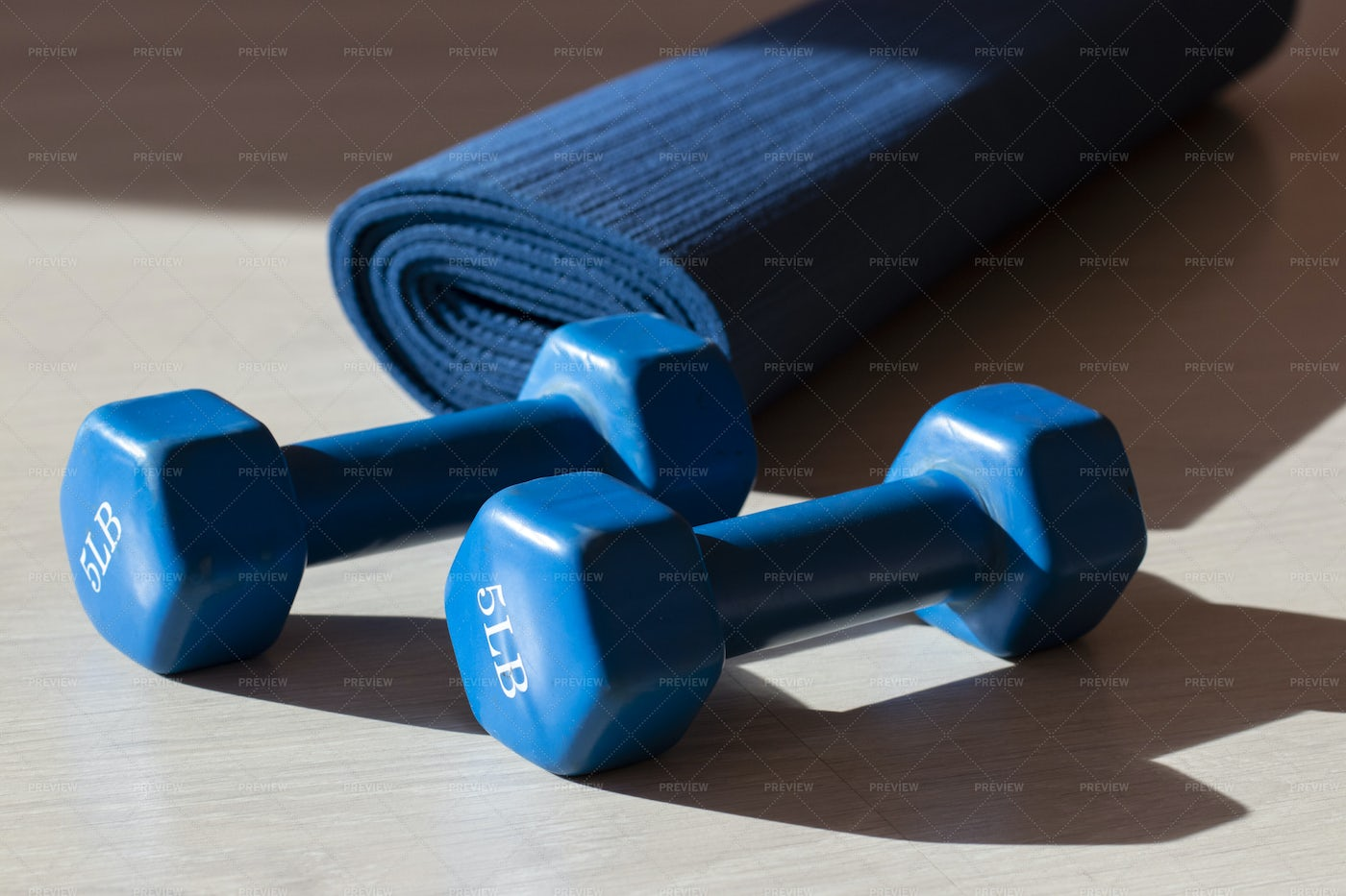 Two Blue Dumbbells And A Yoga Mat: Stock Photos