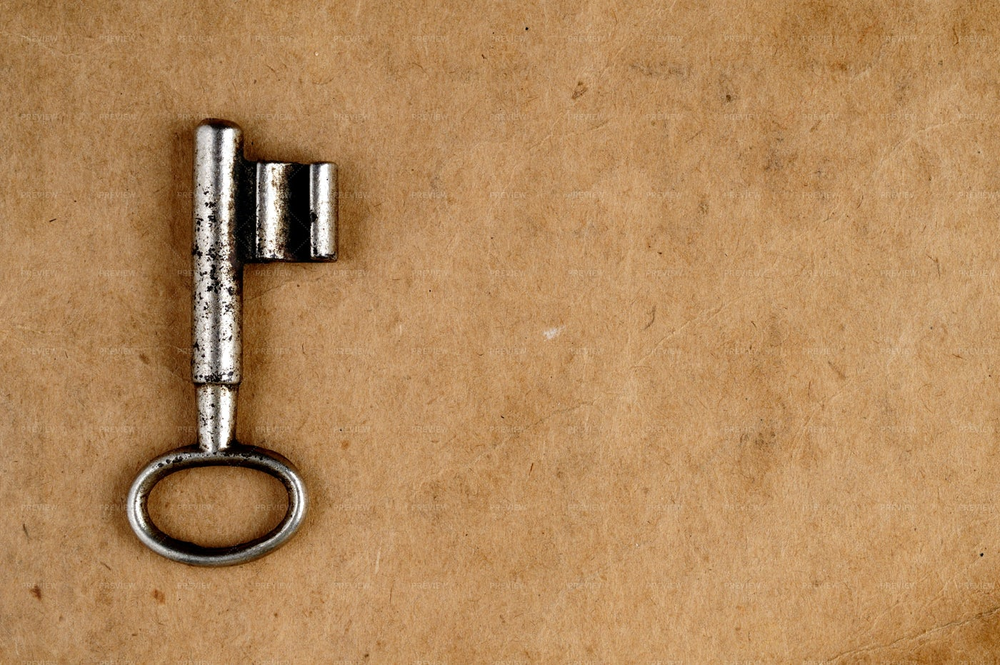 Vintage Key On Old Paper Background: Stock Photos