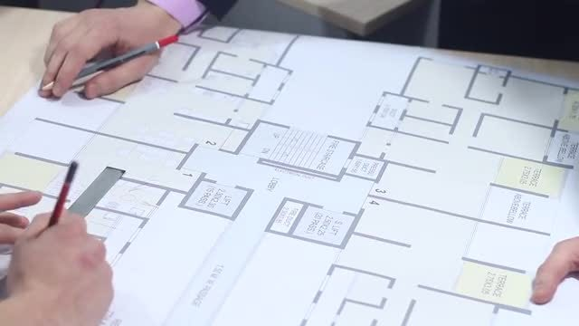 Male Architects Drawing Building Plan: Stock Video