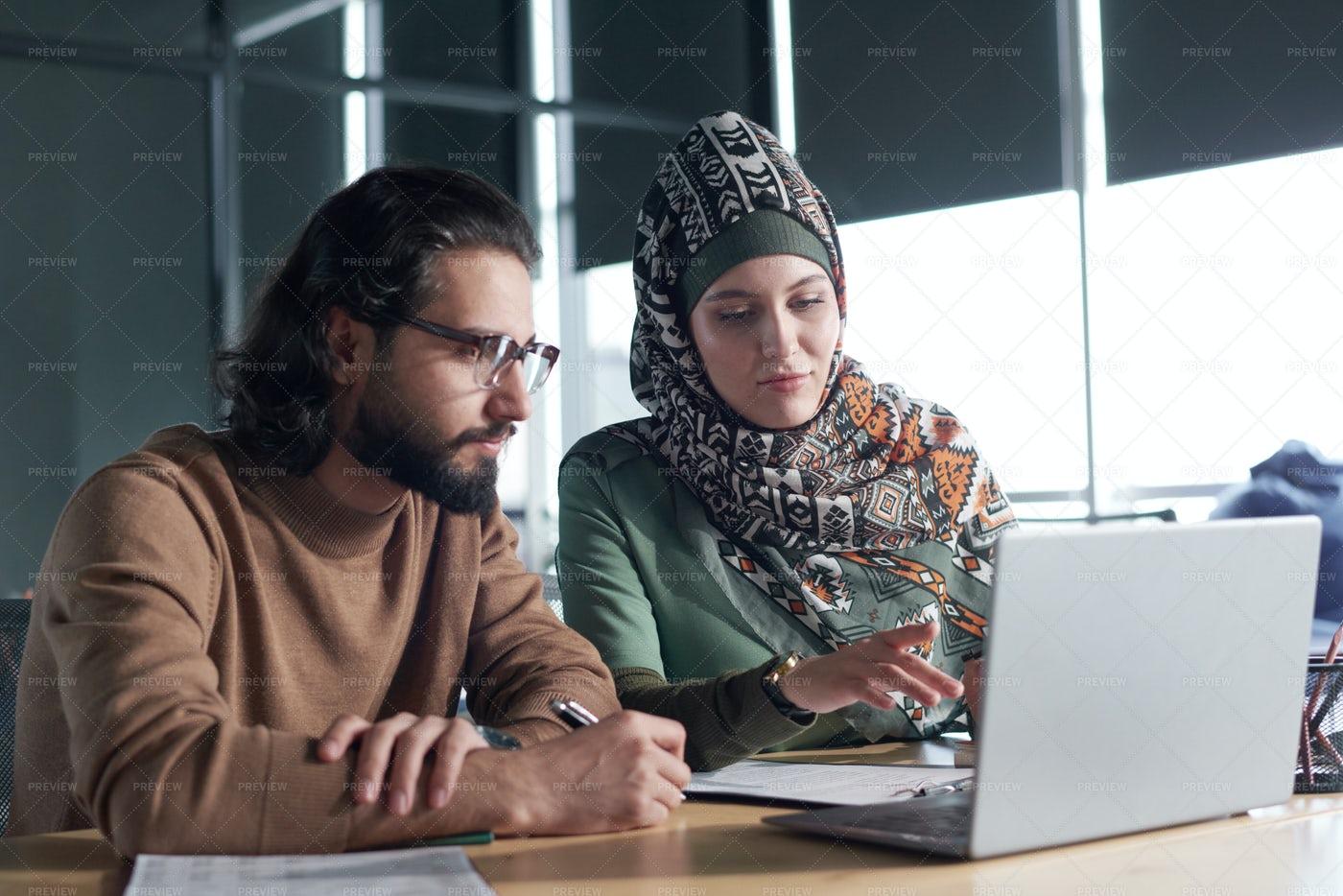 Business Partners Using Laptop At Work: Stock Photos