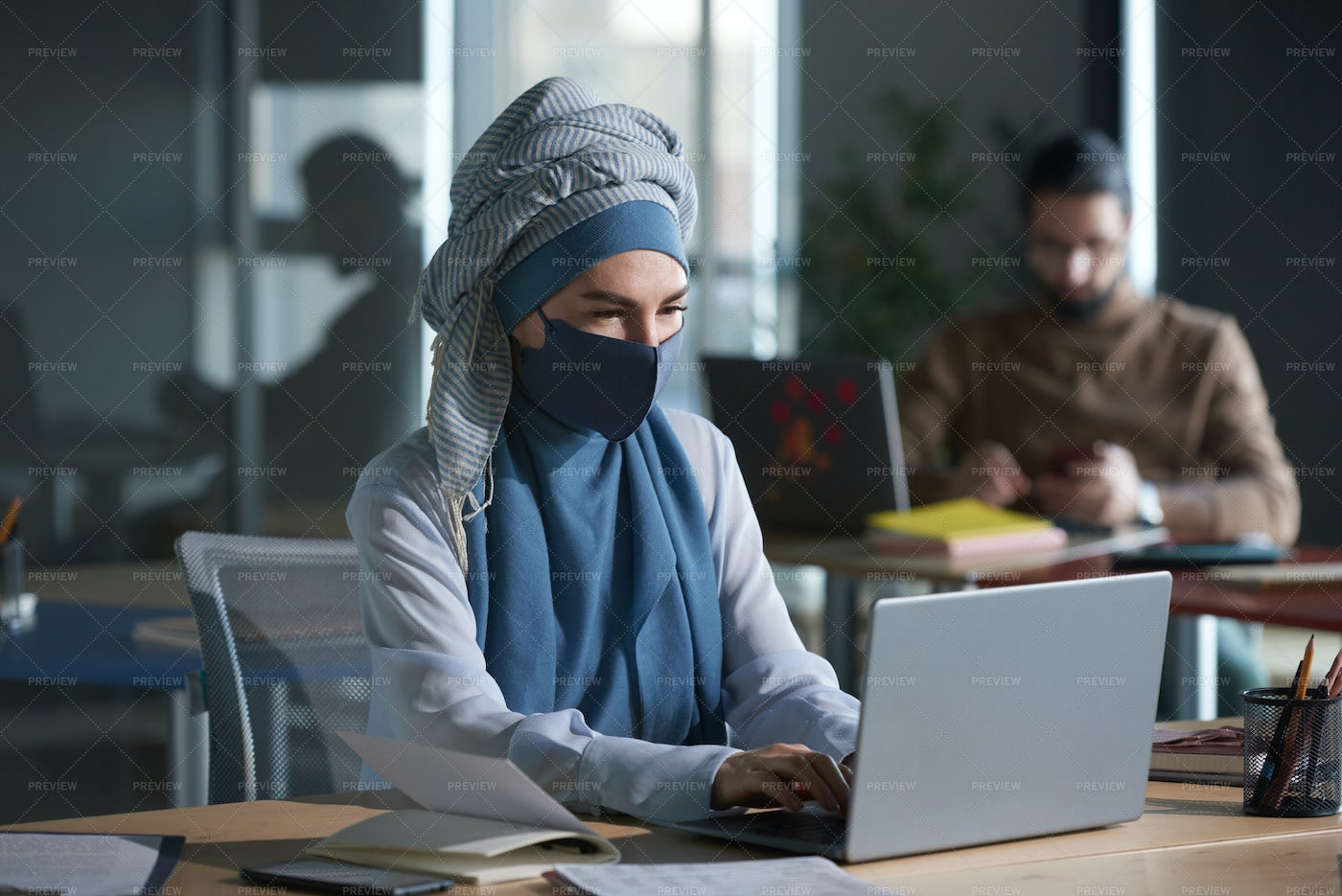 Woman In Mask Working At Office: Stock Photos
