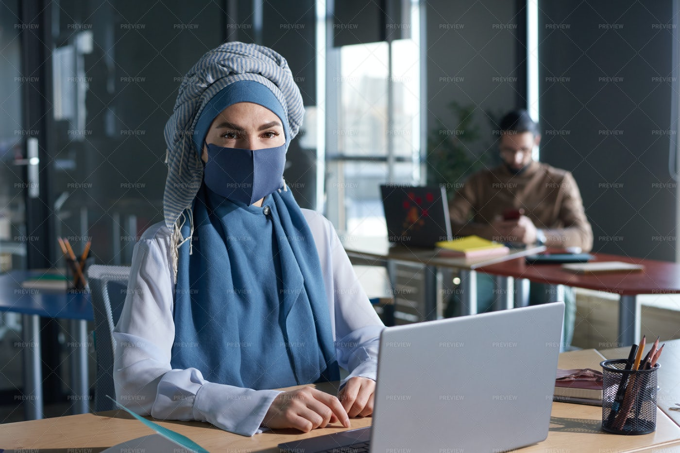 Woman Working During Pandemic: Stock Photos