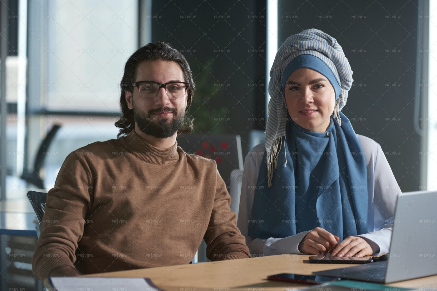 Businessman And Woman At Work: Stock Photos