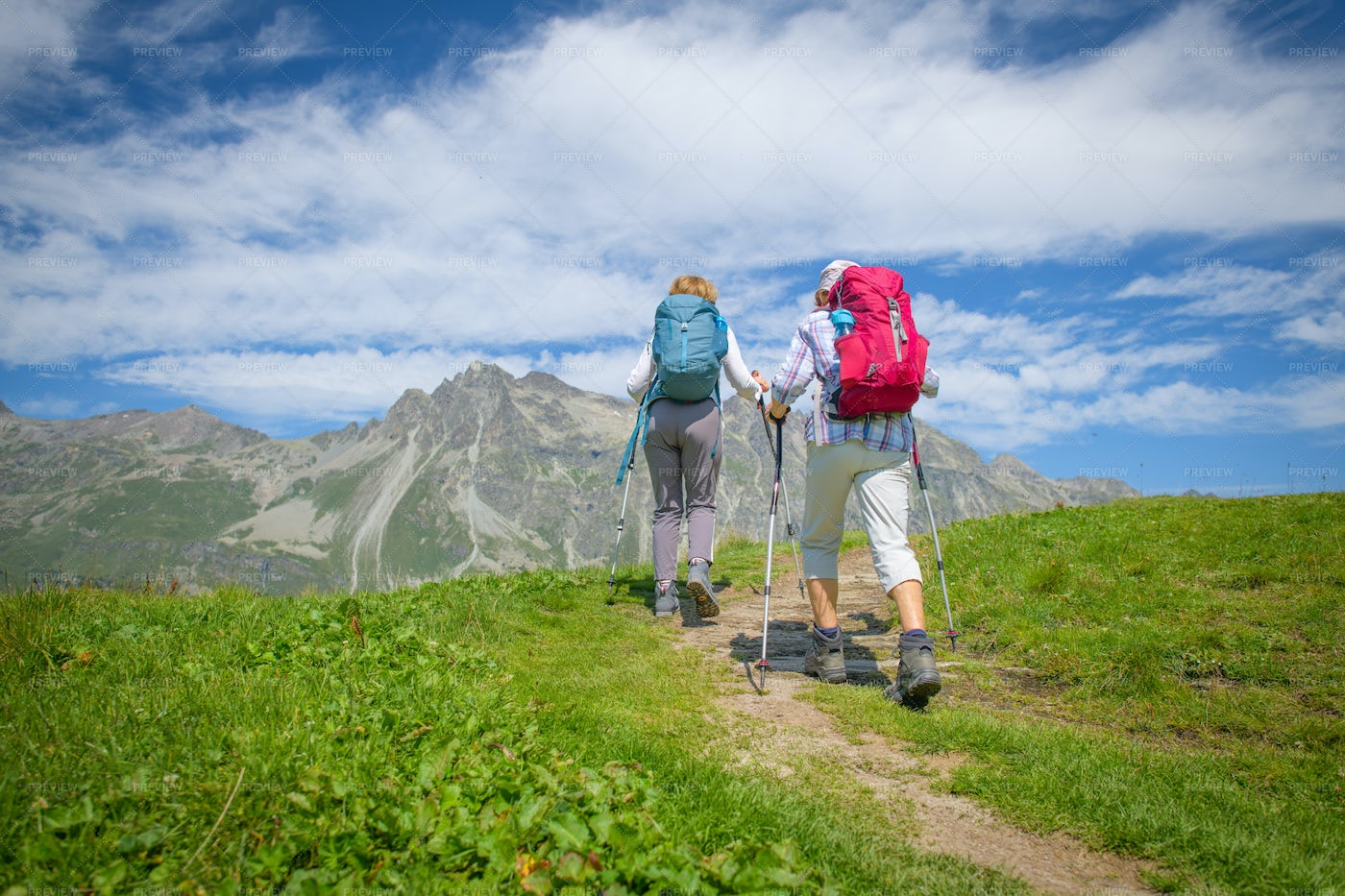 Couple During A Walk In The Mountains: Stock Photos