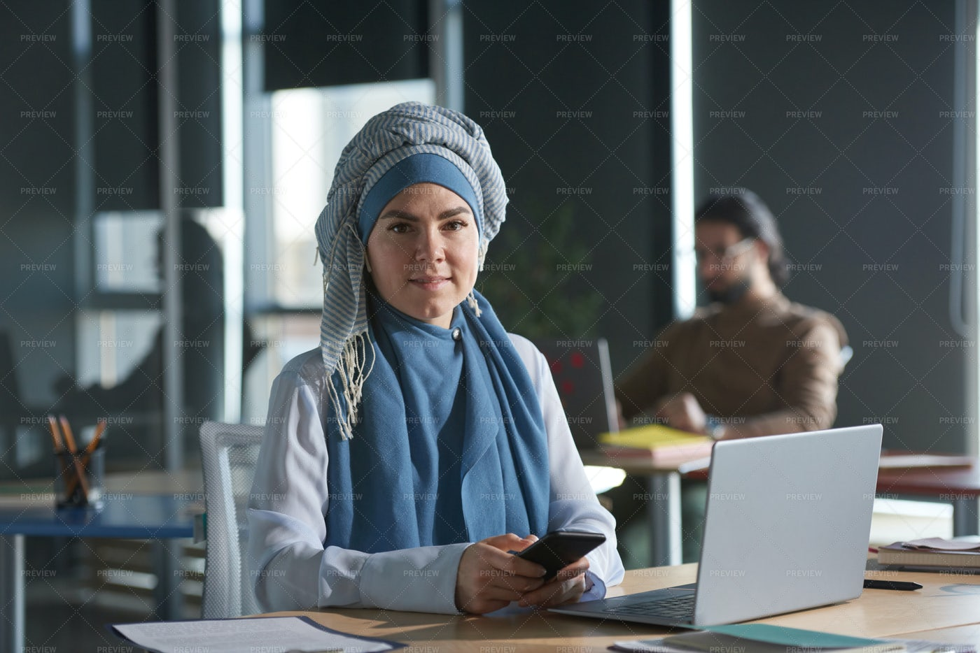 Businesswoman Sitting At Her Work: Stock Photos