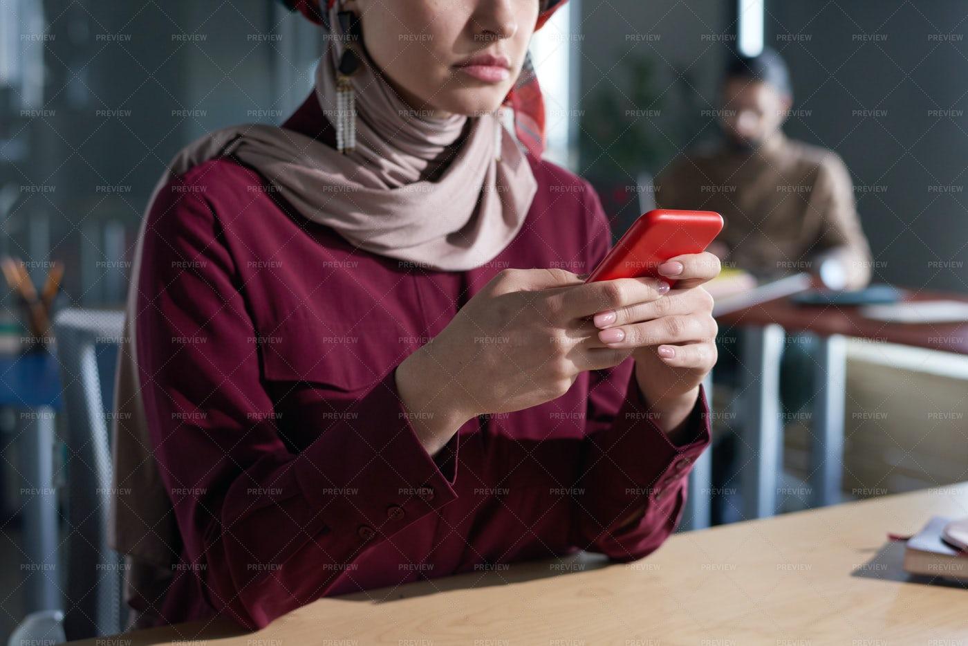 Woman In Hijab Using Phone: Stock Photos