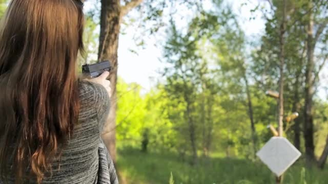 Girl Target Shooting Outdoors : Stock Video