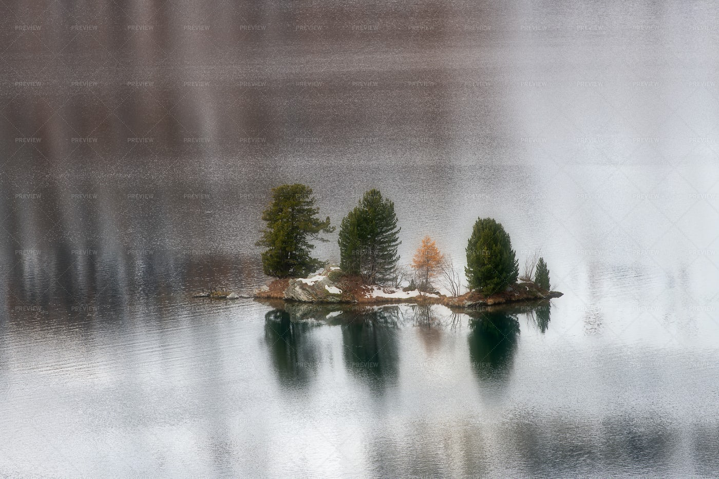 Small Island In A Mountain Lake: Stock Photos