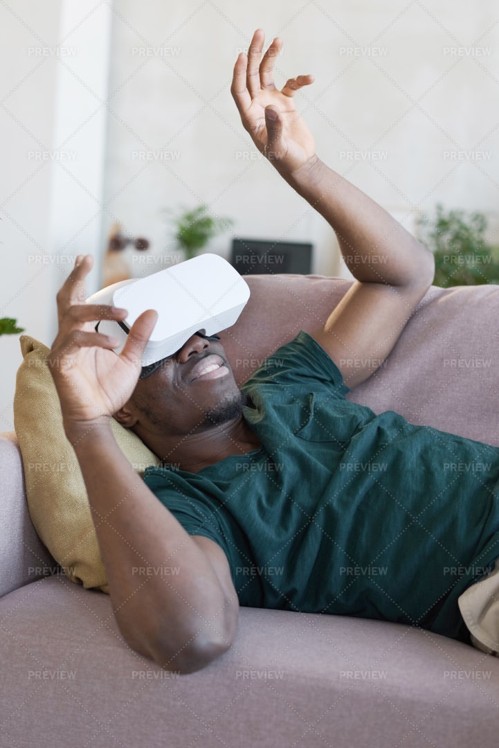 Man In VR Glasses Playing Video Game: Stock Photos