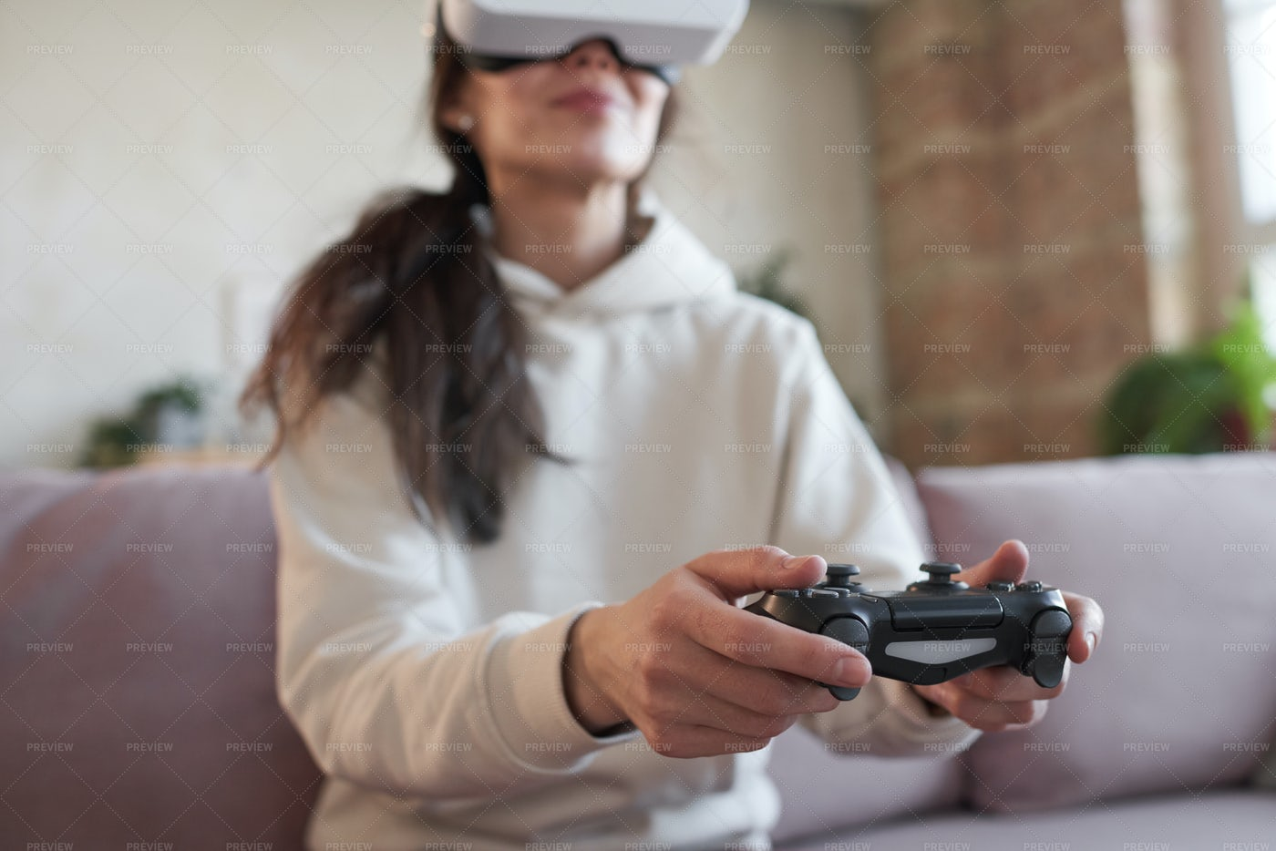 Woman Using Joystick In Game: Stock Photos