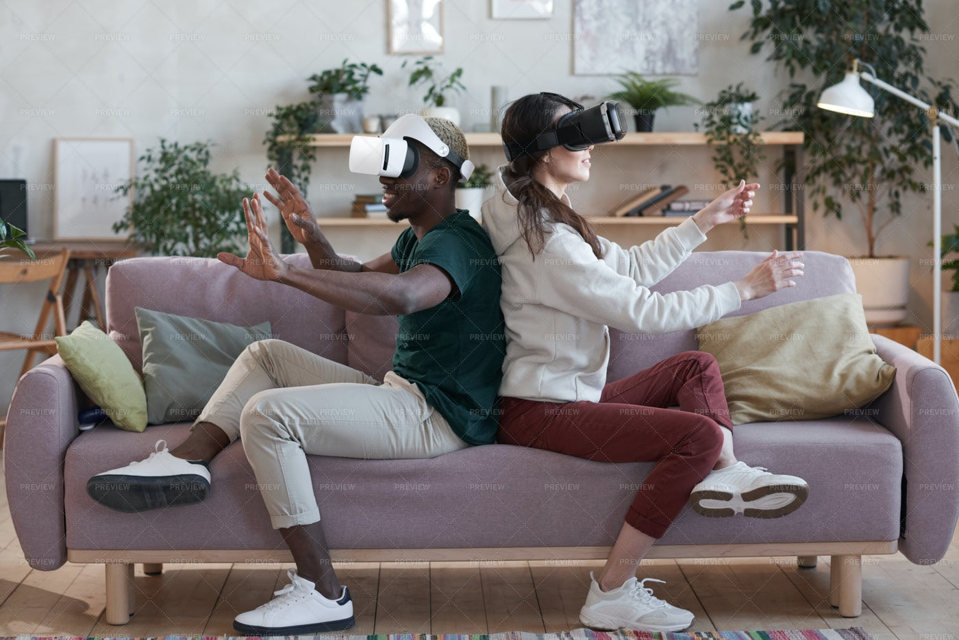 Happy People Playing Game With VR: Stock Photos