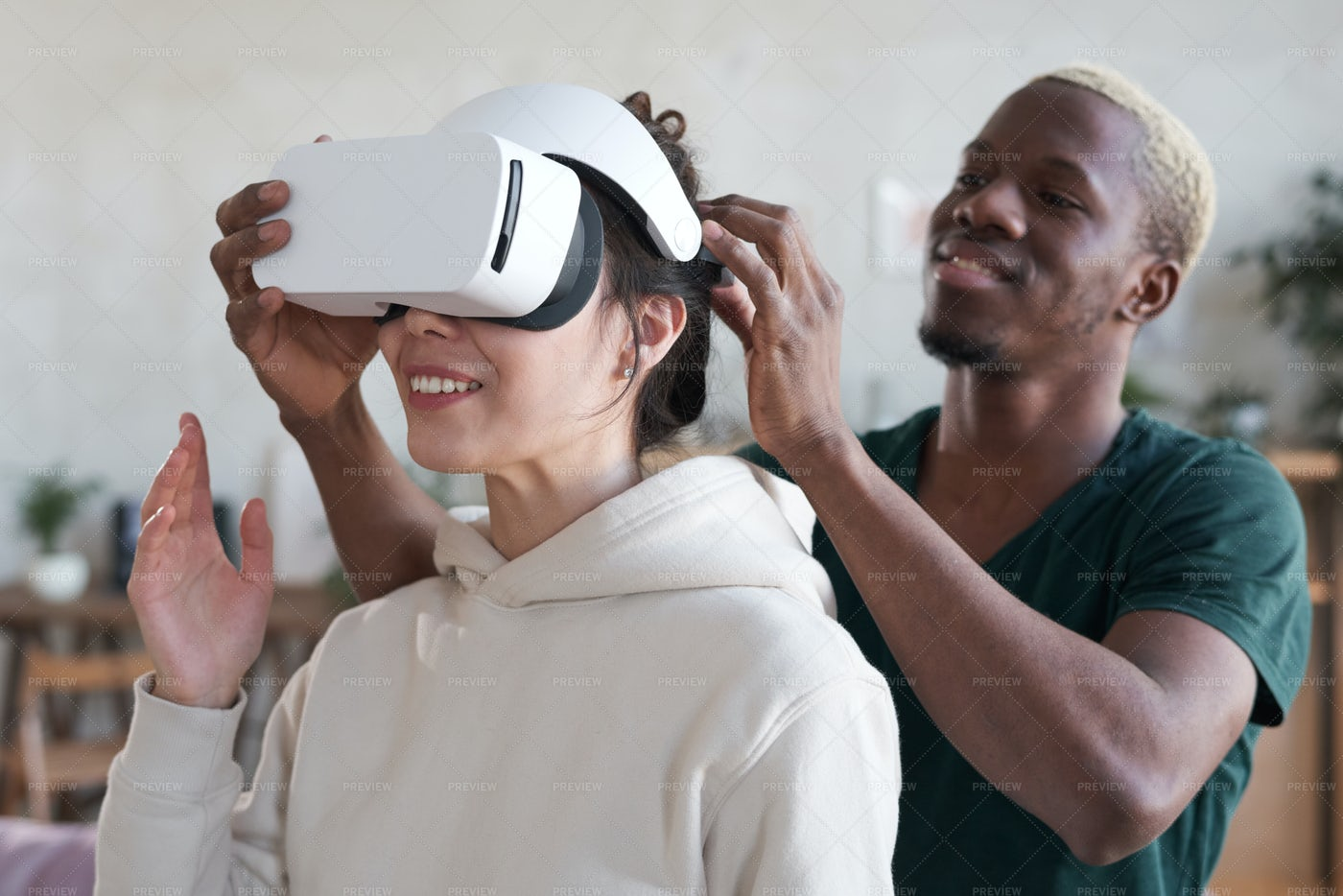 Man Showing Virtual Reality To Woman: Stock Photos