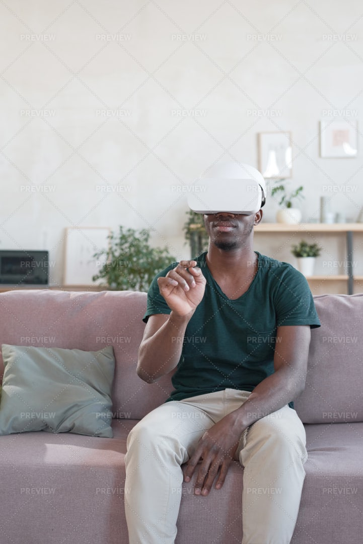 Man Using VR Goggles: Stock Photos