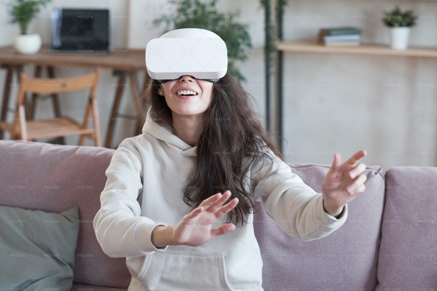 Girl Enjoying Virtual Reality Game: Stock Photos
