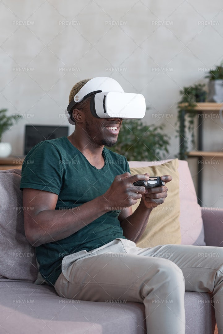 Man In VR Glasses With Joystick Playing: Stock Photos