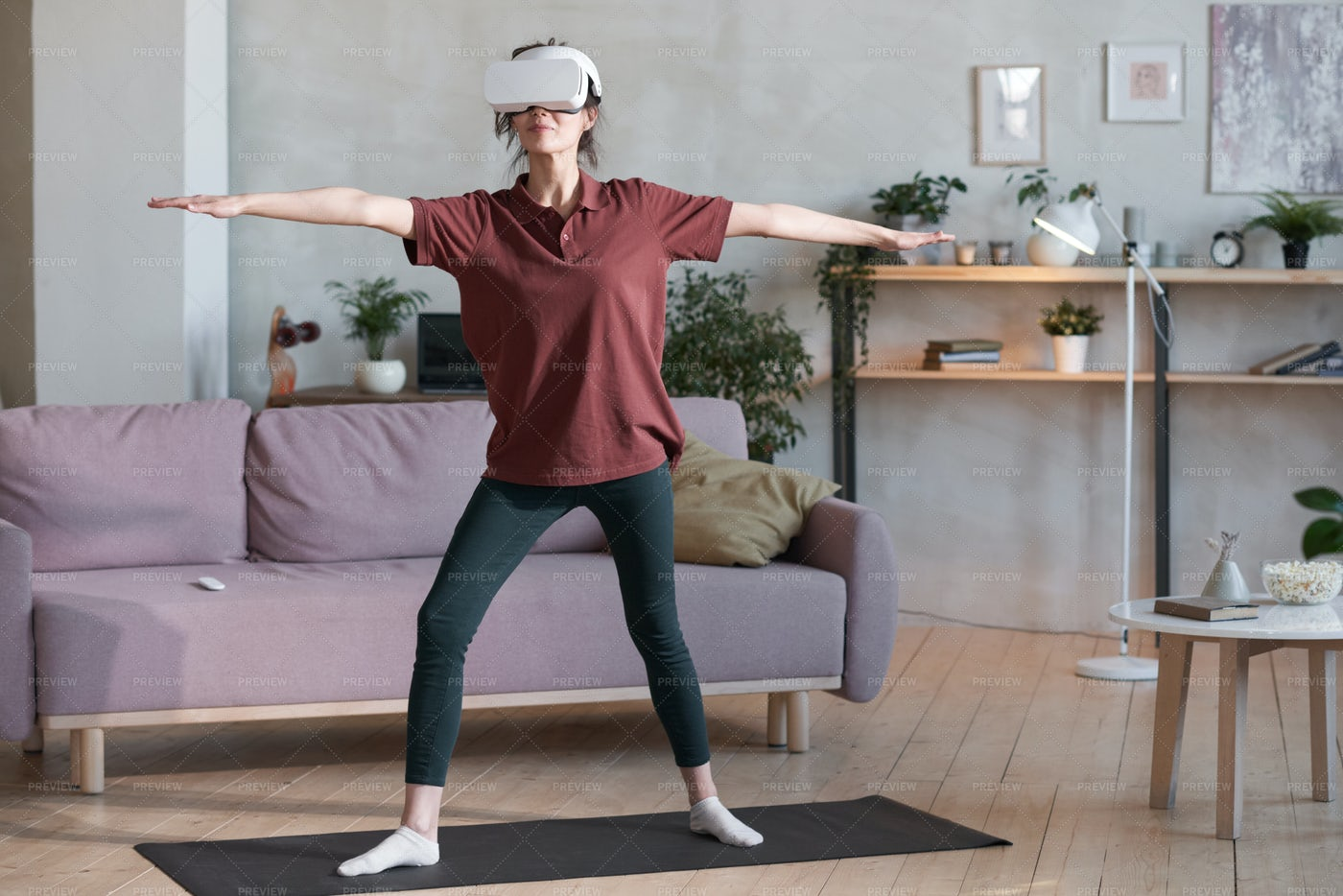 Woman Exercising In VR Headset: Stock Photos