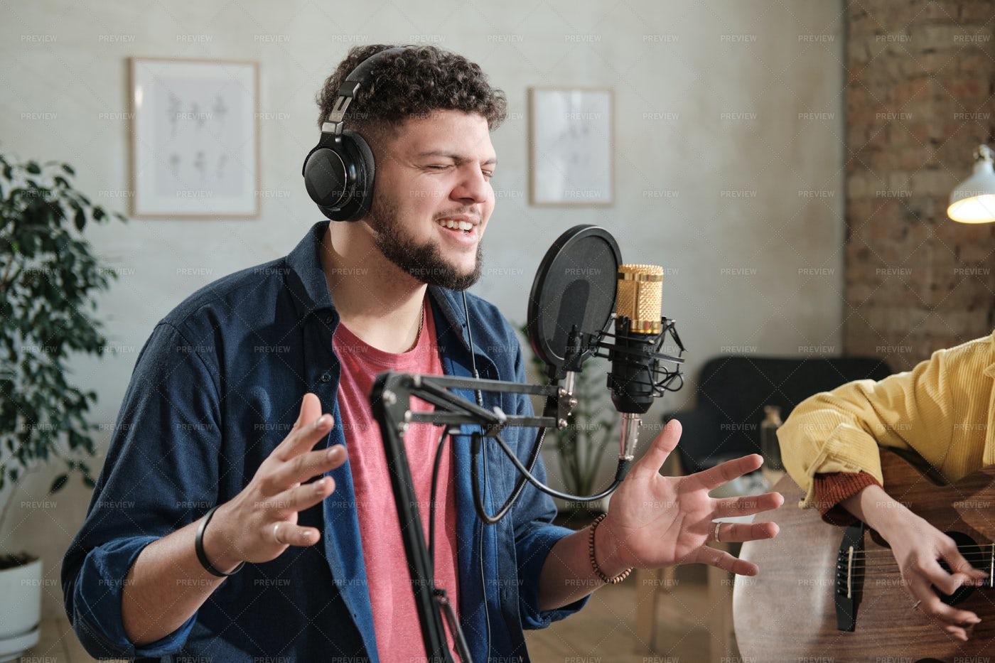 Male Singer Recording A Song: Stock Photos