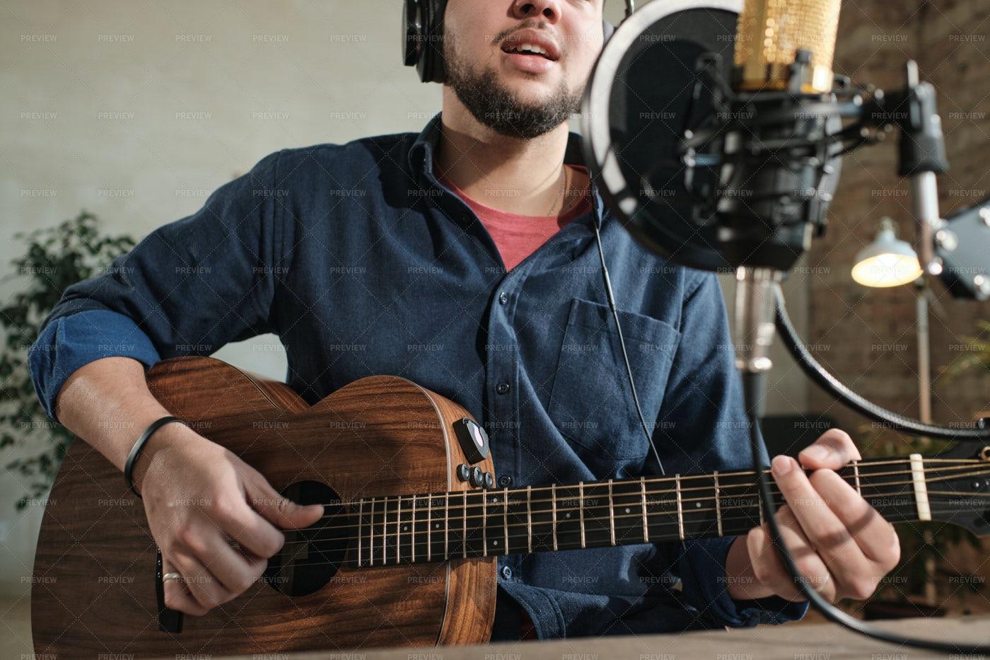 Man Playing Guitar In Studio: Stock Photos
