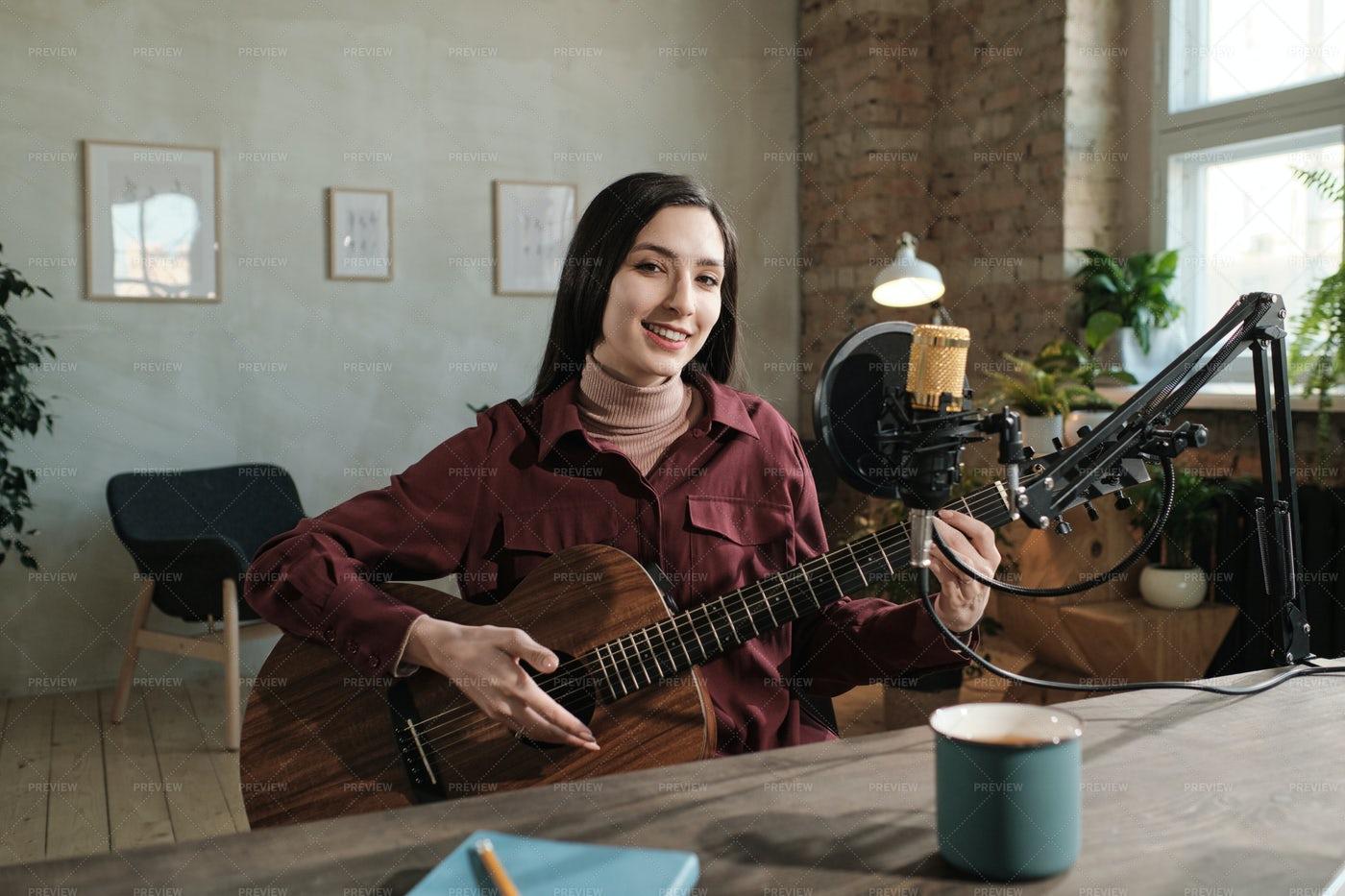 Woman With Guitar: Stock Photos