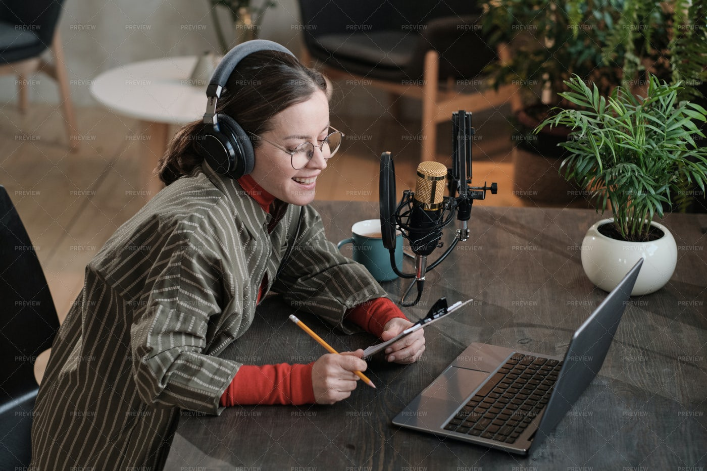 Female Journalist Recording Interview: Stock Photos