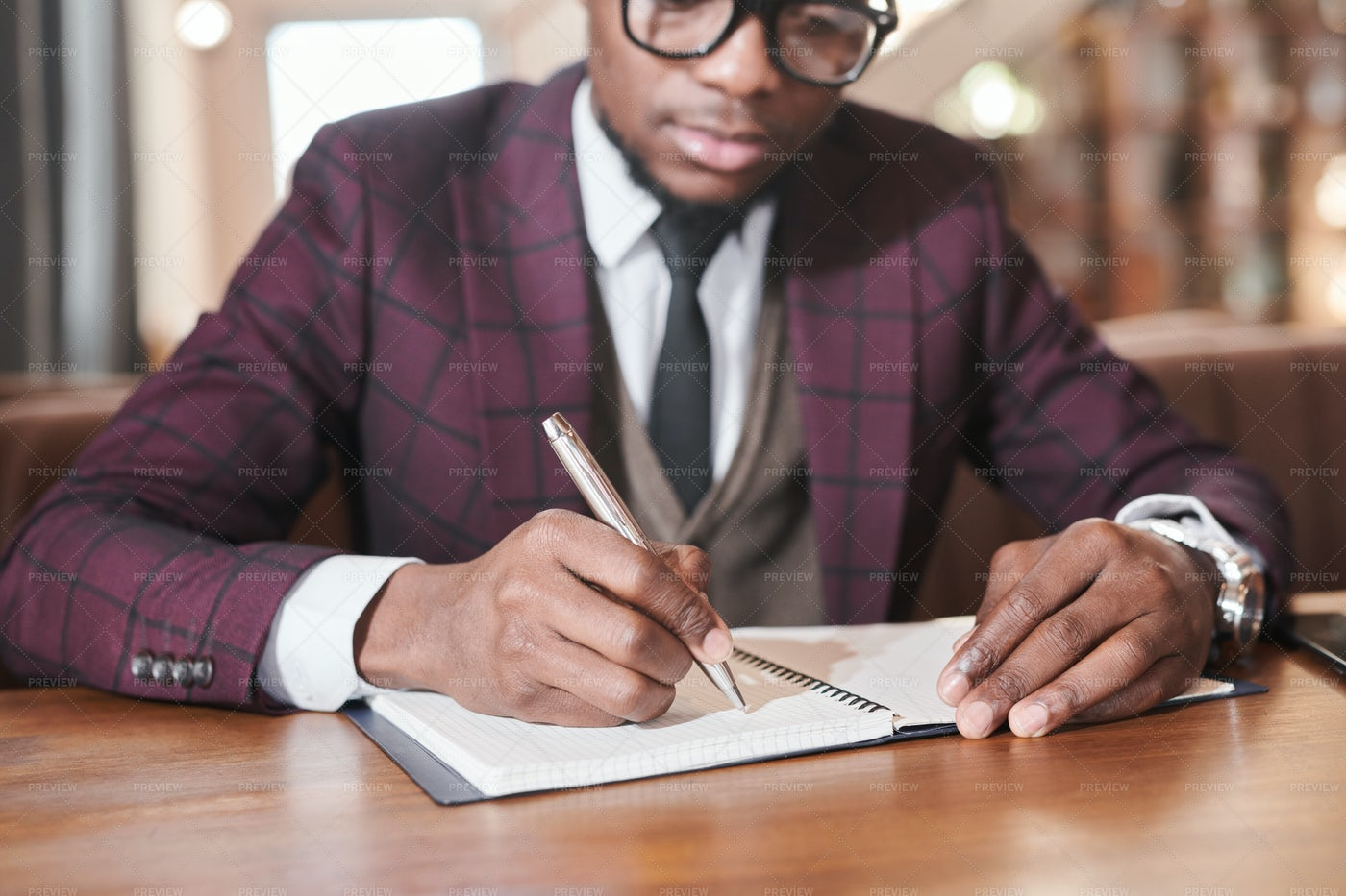 Businessman Writing Plans In Notebook: Stock Photos