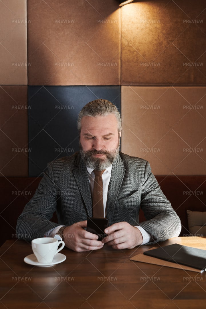 Businessman Using Mobile Phone: Stock Photos