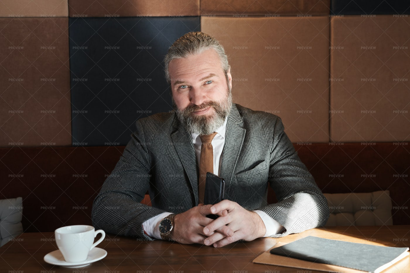 Confident Businessman Sitting In Cafe: Stock Photos
