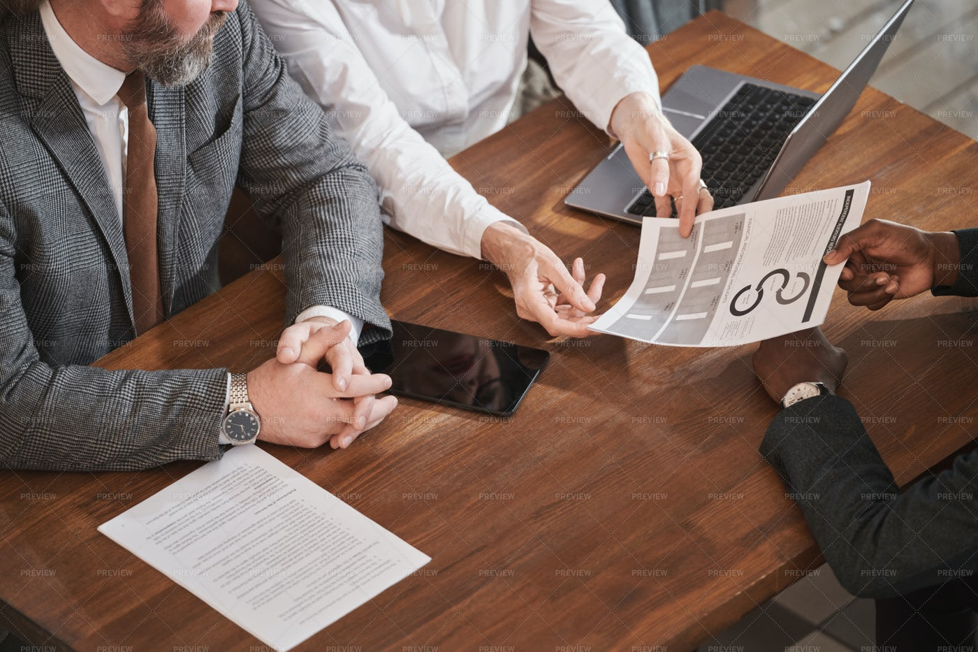 People Working Over Financial Reporting: Stock Photos
