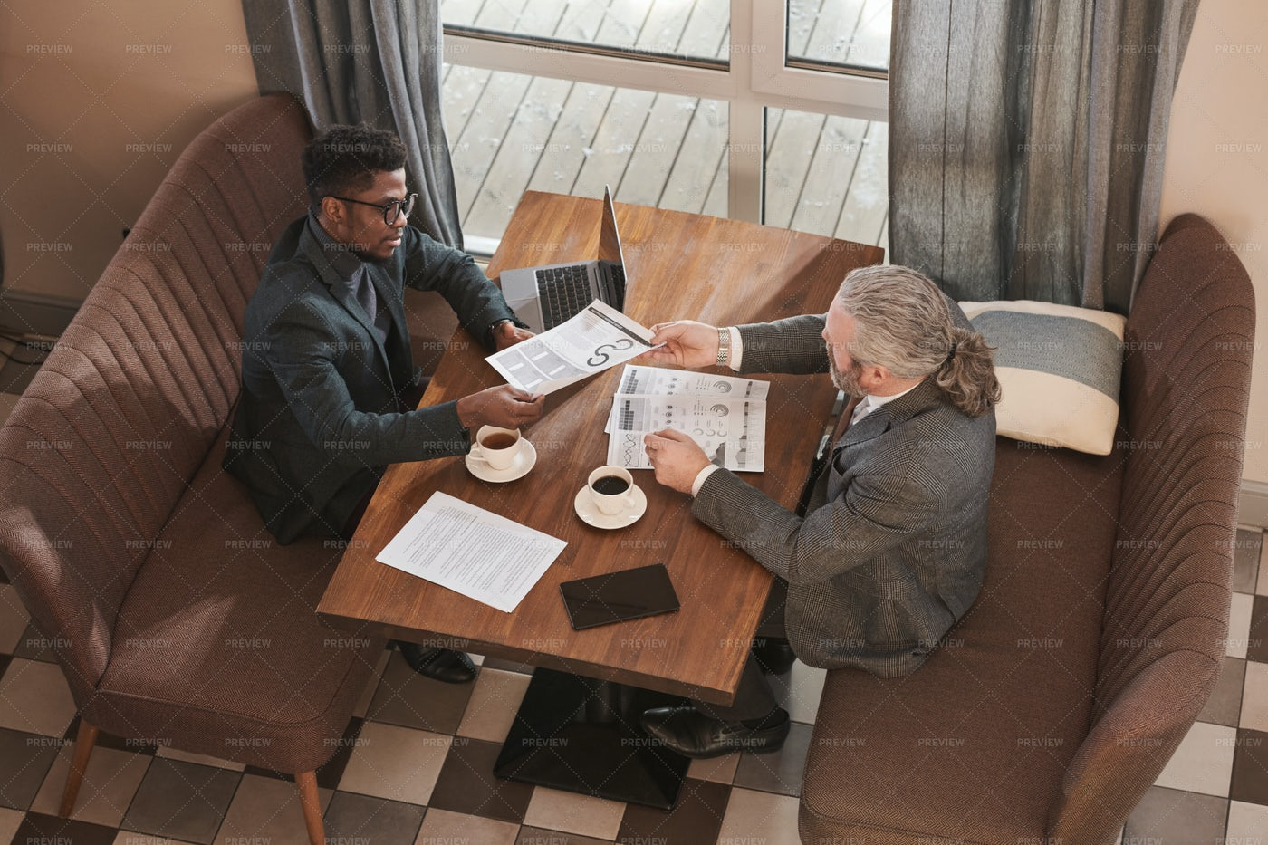 Business Partners Discussing Work: Stock Photos